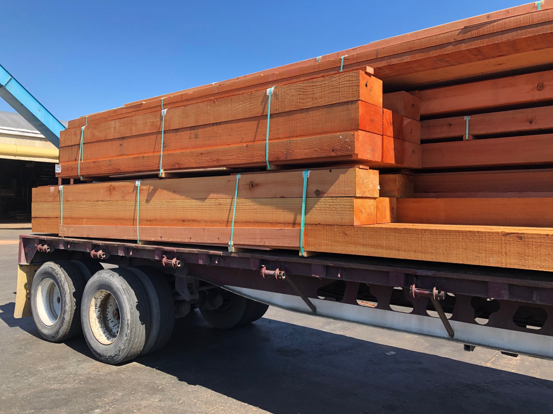 MFP truck loaded with redwood timbers
